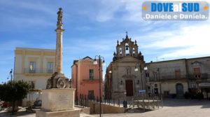 Montescaglioso Piazza Roma, obelisco e chiesa
