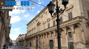 Via Roma con palazzi storici come Palazzo Carissimo